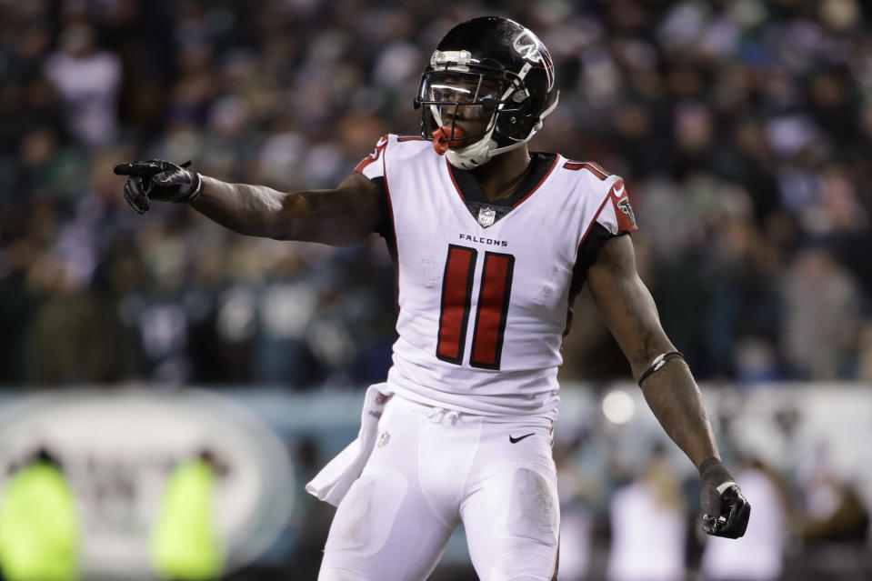 Julio Jones has skipped voluntary team workouts and raised speculation Monday that there's a problem between himself and the Falcons with some social media moves. (AP Photo/Matt Rourke)