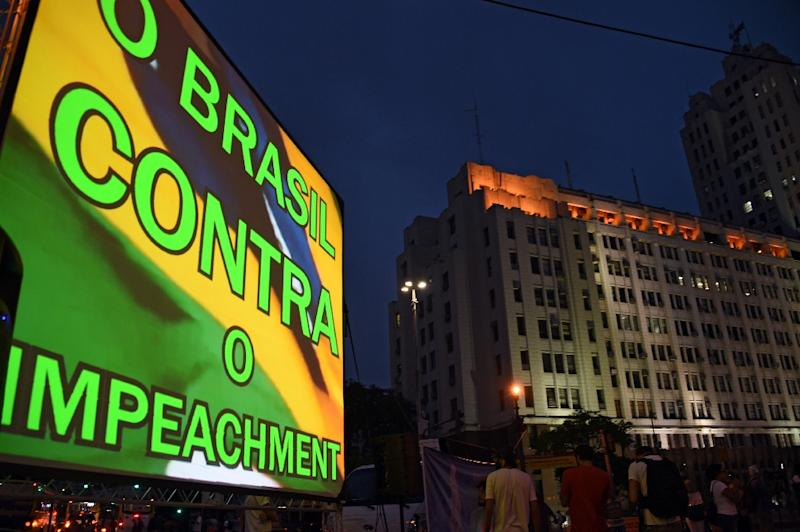 """View of a screen reading """"Brazil against impeachment"""" during a demonstration by Brazilian actors in support of President Dilma Rousseff in Rio de Janeiro (AFP Photo/Vanderlei Almeida)"""