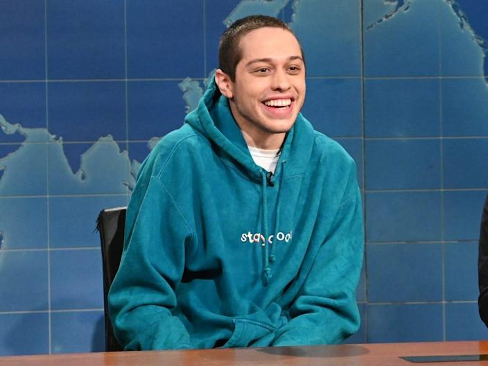 """pete davidson (left) and colin jost (right) during """"SNL"""" weekend updates segment"""