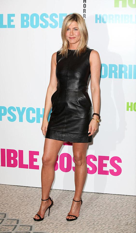 """Jennifer Aniston showed off her deep tan and signature stems upon arriving at a London-based """"Horrible Bosses"""" press conference in an <a href=""""http://omg.yahoo.com/news/jen-aniston-steals-angelina-jolies-look-in-tight-leather-mini-dress/67671"""" target=""""new"""">Angelina Jolie-like look</a>. Do you think Brad's better half would have worked this simple-yet-sexy leather Celine mini and strappy Gucci stilettos better than the former """"Friends"""" star? Jon Furniss/<a href=""""http://www.wireimage.com"""" target=""""new"""">WireImage.com</a> - July 20, 2011"""
