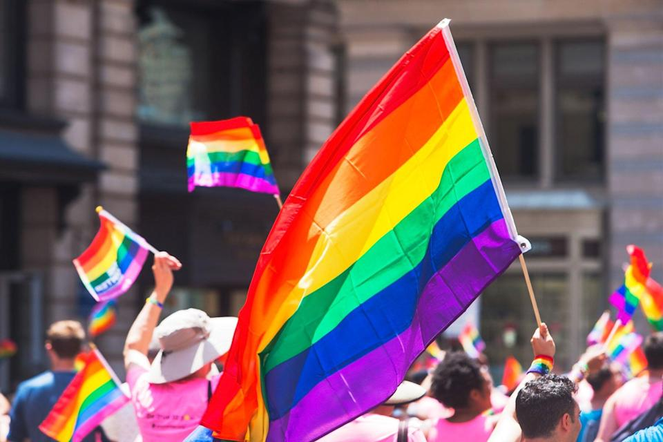 Pride flags being held during parade