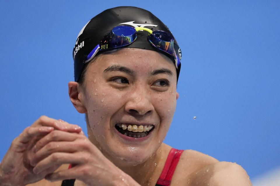 Yui Ohashi, of Japan, celebrates after winning the women's 200-meter individual medley final at the 2020 Summer Olympics, Wednesday, July 28, 2021, in Tokyo, Japan.(AP Photo/Charlie Riedel)