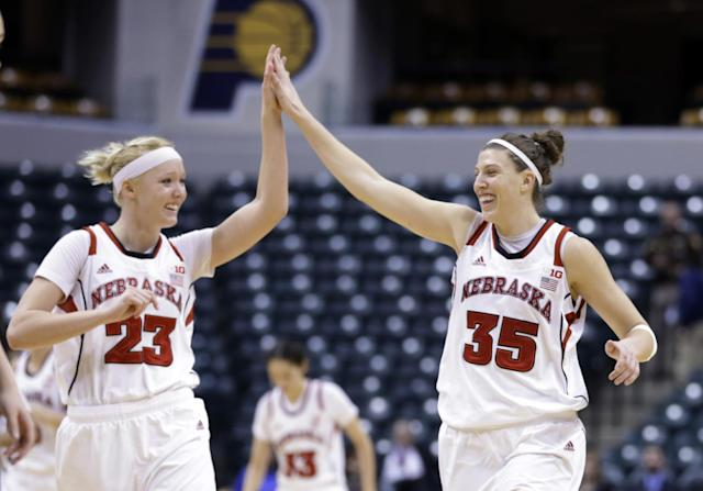 Nebraska's Emily Cady, left, and Jordan Hoope celebrate in the second half of an NCAA college basketball game against Iowa in the finals of the Big Ten women's tournament in Indianapolis, Sunday, March 9, 2014. Nebraska won 72-65. (AP Photo/Michael Conroy)
