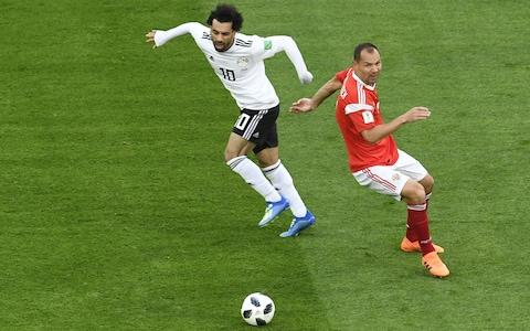 Egypt's forward Mohamed Salah dribbles past Russia's defender Sergey Ignashevich - Credit: AFP