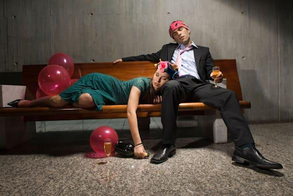Exhausted drunk couple passed out from partying