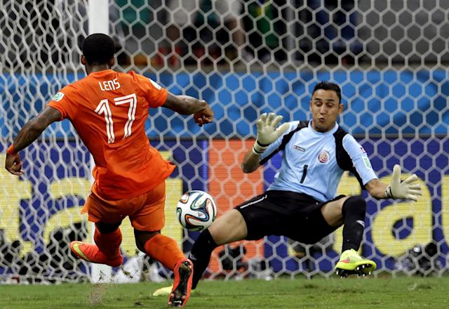 Costa Rica's goalkeeper Keylor Navas (1) saves a shot from Netherlands' Jeremain Lens (17) during extra time of the World Cup quarterfinal soccer match between the Netherlands and Costa Rica at the Arena Fonte Nova in Salvador, Brazil, Saturday, July 5, 2014. (AP Photo/Hassan Ammar)