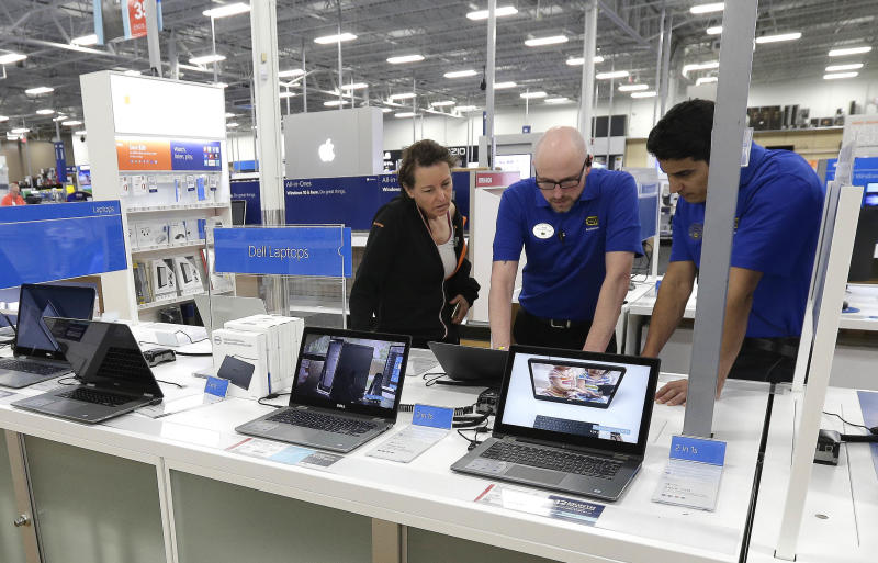 In this Tuesday, May 23, 2017, photo, employees assist a customer with a computer at Best Buy in Cary, N.C. On Wednesday, Sept. 6, 2017, the Institute for Supply Management reports on the August performance of U.S. services firms. (AP Photo/Gerry Broome)