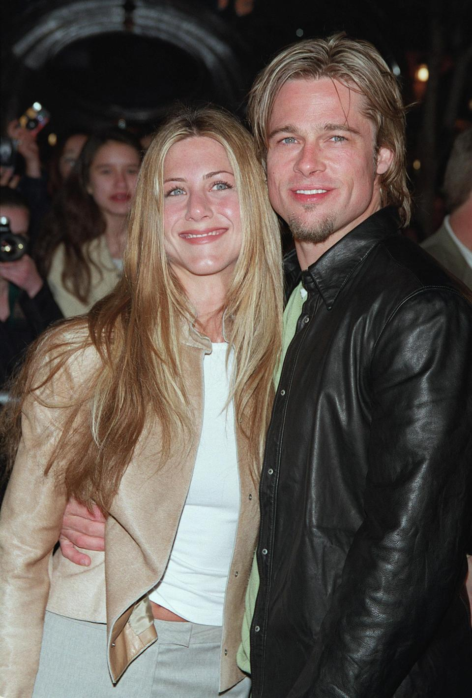 <p>When Jennifer went sleek and straight, Brad went even sleeker and straighter. Photo: Getty Images </p>