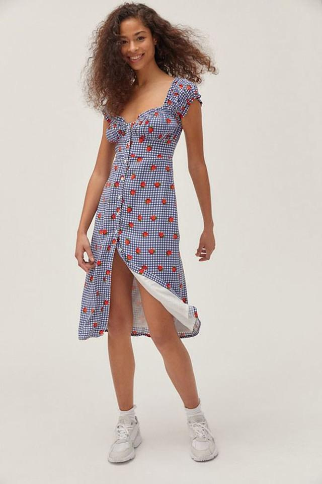 """$79, Urban Outfitters. <a href=""""https://www.urbanoutfitters.com/shop/uo-penelope-strawberry-button-front-midi-dress?category=SEARCHRESULTS&color=049"""">Get it now!</a>"""