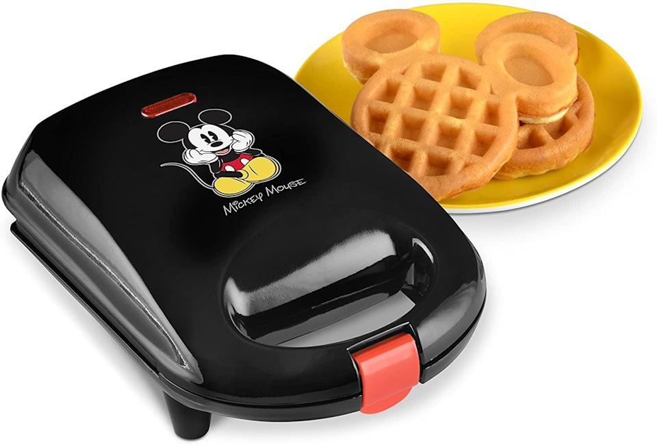 <p>The <span>Disney DCM-9 Mickey Mini Waffle Maker</span> ($13) adds that Disney magic to breakfast (or dinner, we're not judging).</p>