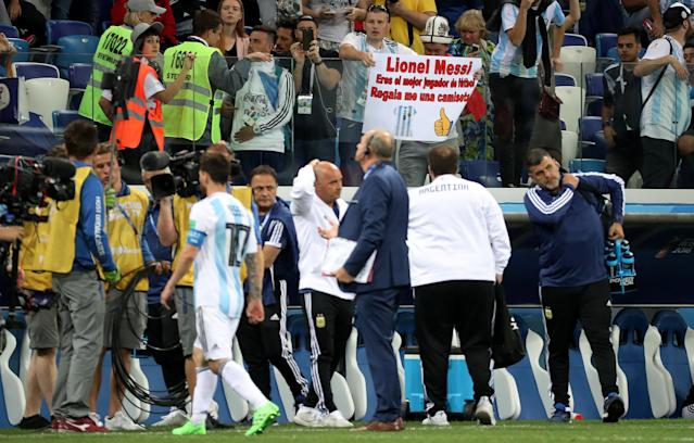 Soccer Football - World Cup - Group D - Argentina vs Croatia - Nizhny Novgorod Stadium, Nizhny Novgorod, Russia - June 21, 2018 Argentina fan holds up a sign referencing Lionel Messi after the match REUTERS/Lucy Nicholson
