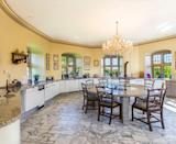 """<p>Grand and imposing, the <a href=""""https://www.countryliving.com/uk/homes-interiors/interiors/g32846553/small-kitchen-storage-ideas/"""" rel=""""nofollow noopener"""" target=""""_blank"""" data-ylk=""""slk:kitchen"""" class=""""link rapid-noclick-resp"""">kitchen</a> area at Walton Castle provides a spacious entertaining space for all. </p>"""