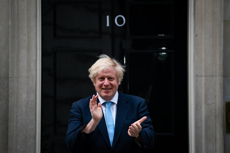 Prime Minister Boris Johnson stands in Downing Street, London, to join in the applause to salute local heroes during Thursday's nationwide Clap for Carers to recognise and support NHS workers and carers fighting the coronavirus pandemic.