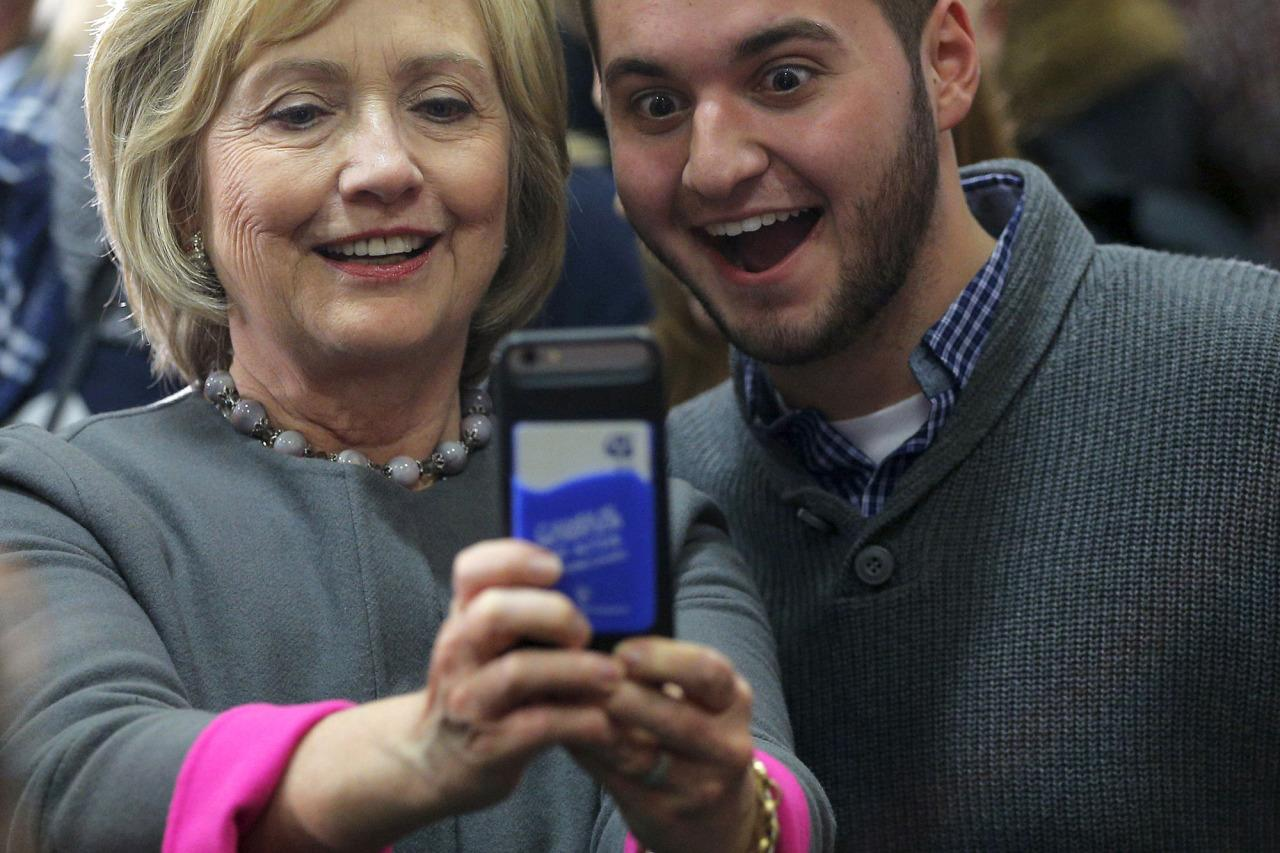 <p>U.S. Democratic presidential candidate Hillary Clinton poses for a selfie with an audience member at a campaign town hall meeting in Dover, N.H., Dec. 3, 2015. (Photo: Brian Snyder/Reuters)</p>