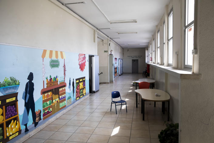 A closed primary school is seen in Ramat Gan, Israel, Sunday, March 15, 2020. Israel has imposed a number of tough restrictions to slow the spread of the new coronavirus. Netanyahu announced that schools, universities, restaurants and places of entertainment will be closed to stop the spread of the coronavirus. He also encouraged people not to go to their workplaces unless absolutely necessary. For most people, the new coronavirus causes only mild or moderate symptoms. For some it can cause more severe illness. (AP Photo/Oded Balilty)