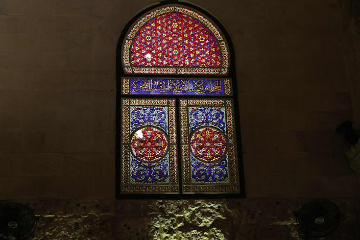 Pieces of stained glass broken from one of Al-Aqsa mosque's windows on May 10, 2021.