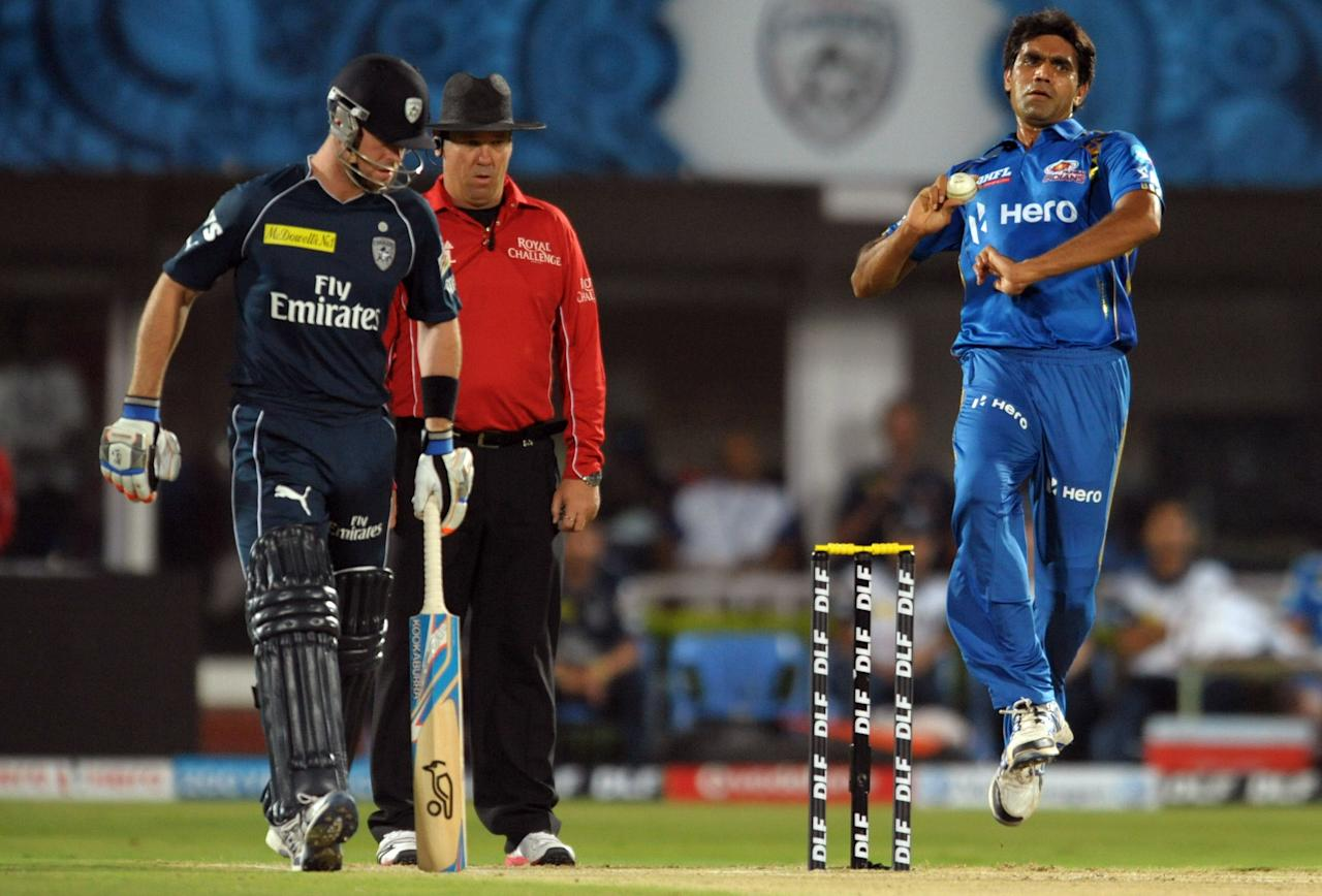 Mumbai Indians  Munaf Patel(R) bowls as Deccan Chargers batsman Daniel Christian watches during the IPL Twenty20  match between Deccan Chargers and Mumbai Indians at Dr. Y.S. Rajasekhara Reddy Cricket Stadium in Visakhapatnam on April 9, 2012. AFP PHOTO / Noah SEELAM.RESTRICTED TO EDITORIAL USE. MOBILE USE WITHIN NEWS PACKAGE. . (Photo credit should read NOAH SEELAM/AFP/Getty Images)