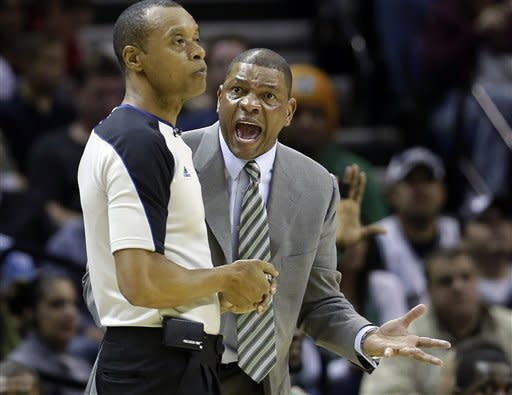 Boston Celtics head coach Doc Rivers, right, argues a call with an official during the second quarter of an NBA basketball game, Saturday, Dec. 15, 2012, in San Antonio. (AP Photo/Eric Gay)