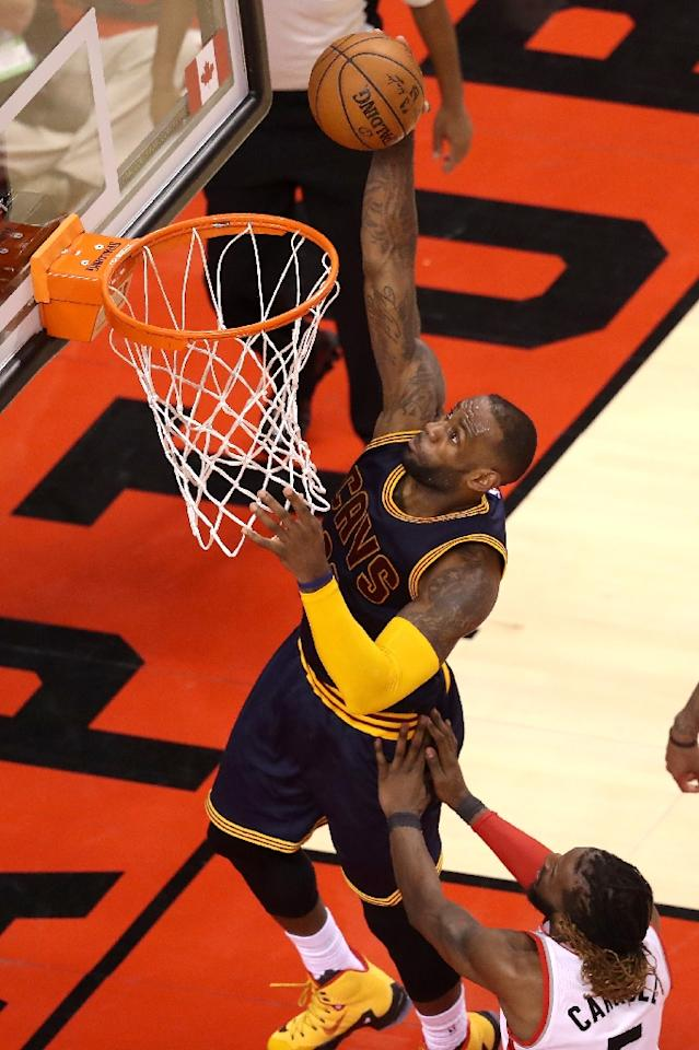 The Cavaliers rallied superbly through LeBron James, who finished with 29 points (AFP Photo/Tom Szczerbowski)