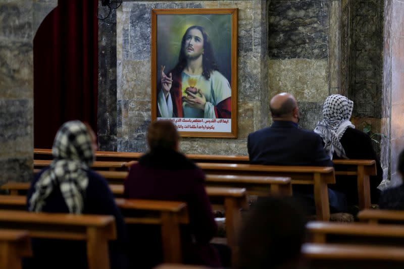 A picture of Jesus Christ is seen on the wall of the Grand Immaculate old Church in Qaraqosh