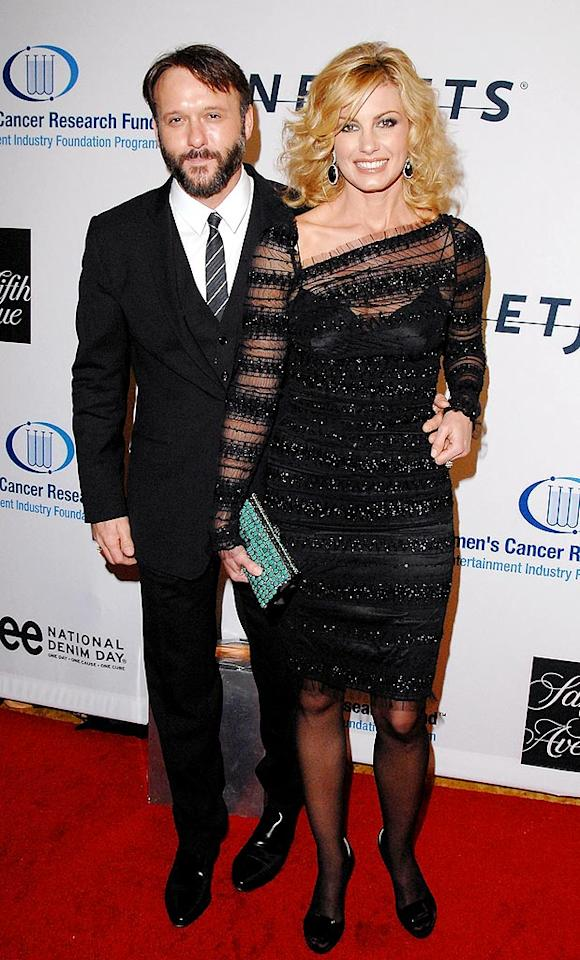"Although they've walked countless red carpets together, country music's first couple Tim McGraw and Faith Hill looked a little out of place here. Do you think Tim or Faith wore their fancy threads better? Jon Kopaloff/<a href=""http://www.filmmagic.com/"" target=""new"">FilmMagic.com</a> - January 27, 2010"
