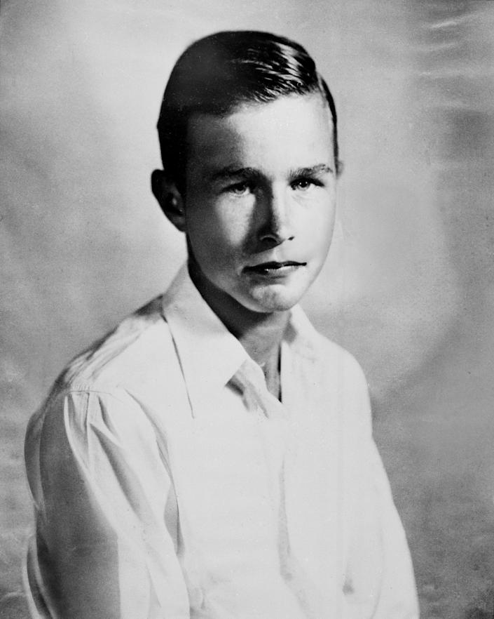 George Bush is shown at age 14 or 15 in 1939. Bush was born in 1924 in Milton, Mass., and grew up in Greenwich, Conn.