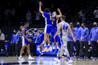 Xavier guards Colby Jones, left, and C.J. Wilcher (0) celebrate the team's 77-69 win over Creighton in an NCAA college basketball game Saturday, Feb. 27, 2021, in Cincinnati. (AP Photo/Aaron Doster)