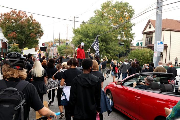 Travis Nagdy, center, leads chants during a march through Louisville in honor of Breonna Taylor. Oct. 10, 2020