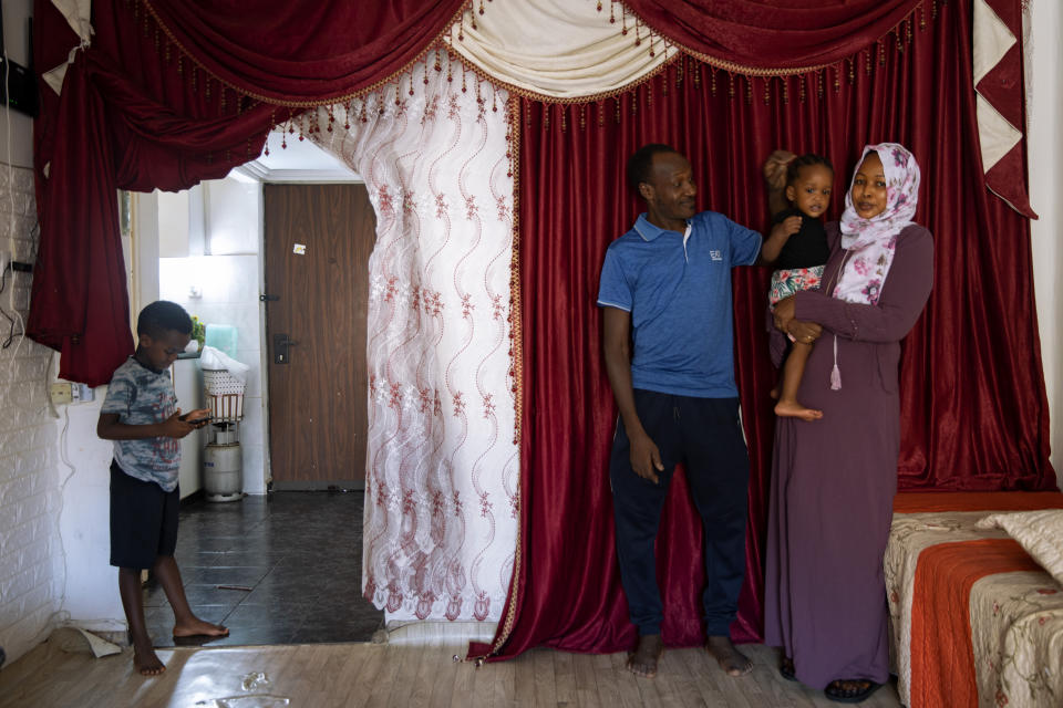 Musa Family, Sudanese migrant pose for a photo at their house in south Tel Aviv, Israel, Friday, Oct. 30, 2020. After Israel and Sudan agreed this month to normalize ties, some 6,000 Sudanese migrants in Israel are again fearing for their fate. Israel has long grappled with how to deal with its tens of thousands of African migrants. (AP Photo/Oded Balilty)