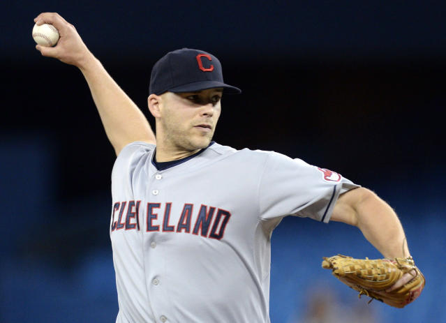 Cleveland Indians starting pitcher Justin Masterson throws against the Toronto Blue Jays during the first inning of a baseball game in Toronto on Tuesday, May 13, 2014. (AP Photo/The Canadian Press, Frank Gunn)