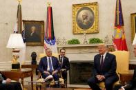 FILE PHOTO: U.S. President Donald Trump meets with Iraq's Prime Minister Mustafa al-Kadhimi in the Oval Office at the White House in Washington