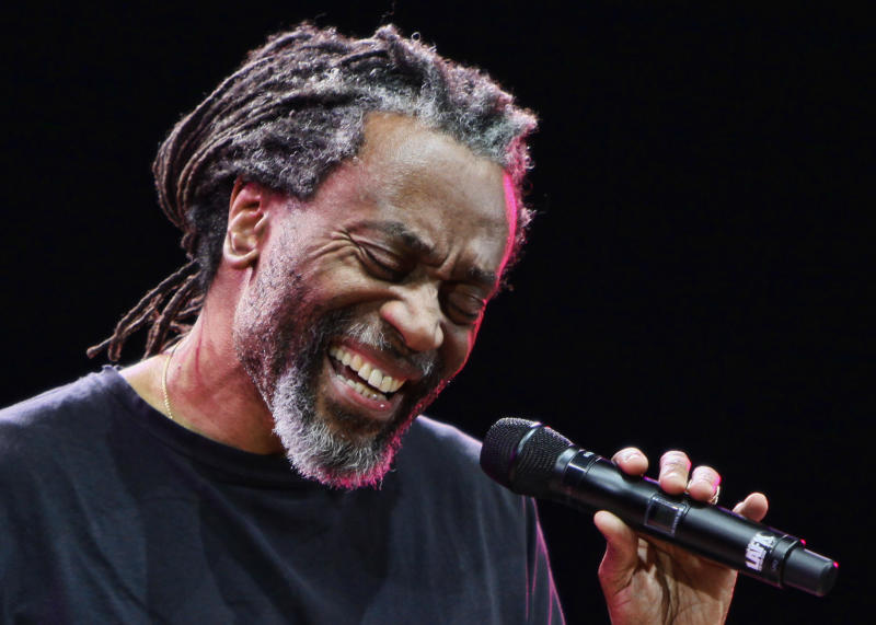 FILE - In this Jan. 27, 2010 file photo, Bobby McFerrin performs at the jazz festival in Kiev, Ukraine.  Paul Simon probably never had a vocal partner quite like Bobby McFerrin, who coaxed him onstage for an impromptu performance of a Simon and Garfunkel hit _ the highlight of opening night of Jazz at Lincoln Center's 25th anniversary season, Friday, Sept. 14, 2012 in New York. (AP Photo/Efrem Lukatsky, File)