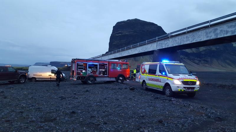 In this UGC photo provided by Tour guide Adolf Erlingsson  on Thursday, Dec. 27, 2018 , emergency services at the scene of a crash, in Skeidararsandur, Iceland.  An SUV carrying seven members of a British family plunged off a high bridge Thursday in Iceland, killing three people and critically injuring the others, authorities said. (Adolf Erlingsson via AP)