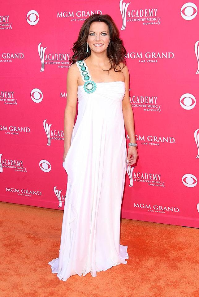 """Martina McBride was a vision in white thanks to her single-shouldered Badgley Mischka gown, which was embellished with turquoise beads. Jason Merritt/<a href=""""http://www.gettyimages.com/"""" target=""""new"""">GettyImages.com</a> - April 5, 2009"""