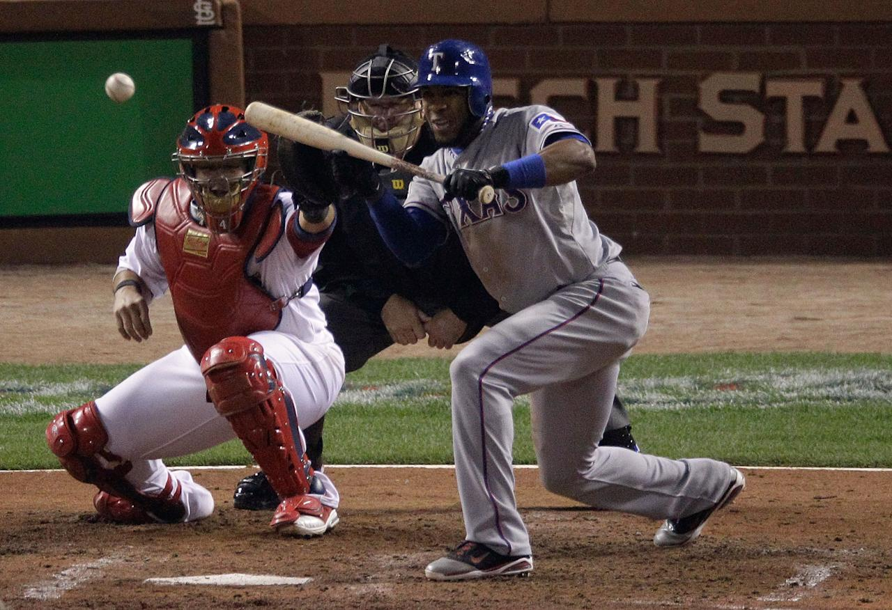 ST LOUIS, MO - OCTOBER 28: Elvis Andrus #1 of the Texas Rangers hits a sacrifice bunt to advance Ian Kinsler #5 in the fifth inning during Game Seven of the MLB World Series against the St. Louis Cardinals at Busch Stadium on October 28, 2011 in St Louis, Missouri.  (Photo by Rob Carr/Getty Images)