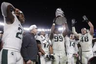 Michigan State's Raequan Williams (99) holds up the trophy after the team's Pinstripe Bowl NCAA college football game against Wake Forest on Friday, Dec. 27, 2019, in New York. Michigan State won 27-21. (AP Photo/Frank Franklin II)