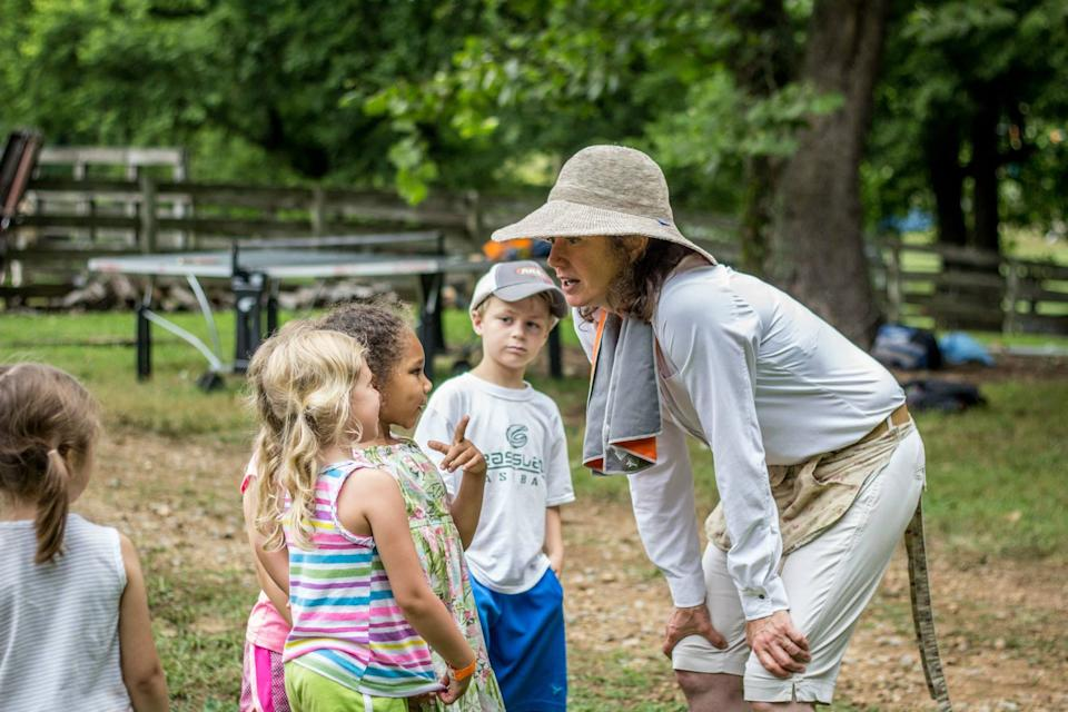 In this 2016 picture, Amy Grant talks to campers at Barefoot at the Farm, a Christian day camp held on Grant's Williamson County farm each summer. The camp aims to bring together children of different races, economic levels and cultures. Half the camp's spots are reserved for children from low-income families.