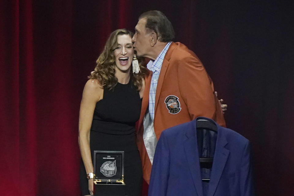 Two-time NBA champion coach Rudy Tomjanovich kisses one of his daughters at the 2020 Basketball Hall of Fame awards tip-off celebration and awards gala, Friday, May 14, 2021, in Uncasville, Conn. (AP Photo/Kathy Willens)