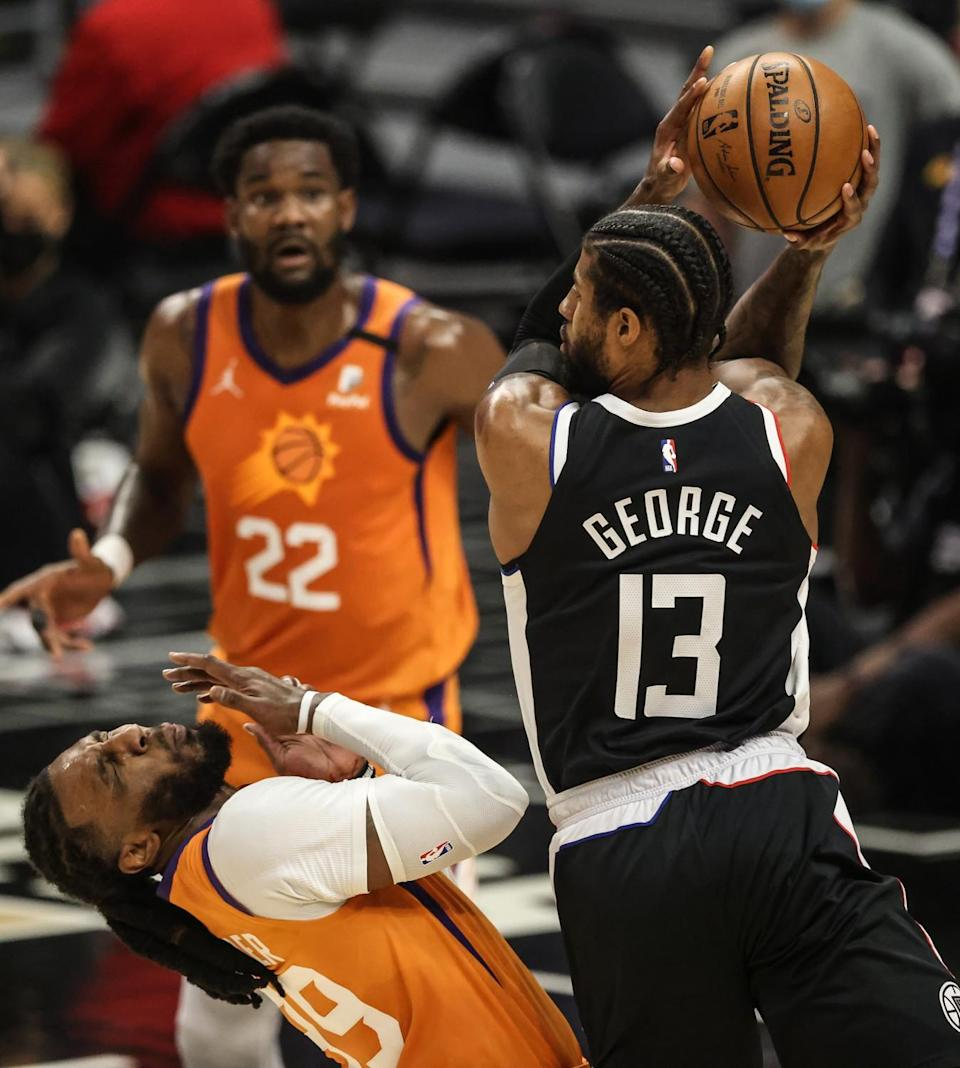 Suns forward Jae Crowder recoils after getting hit in the face by an elbow of Clippers forward Paul George.
