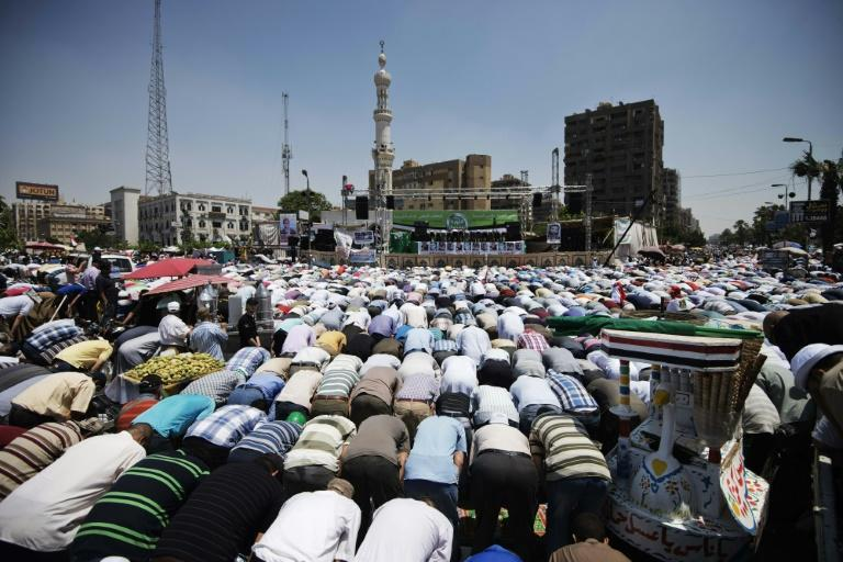 Thousands of Islamists and Muslim Brotherhood supporters perform the Friday prayers as they gather at Rabaa al-Adawiya mosque to start an open-ended sit-in in support of the legitimacy of President Mohamed Morsi in Cairo on June 28, 2013