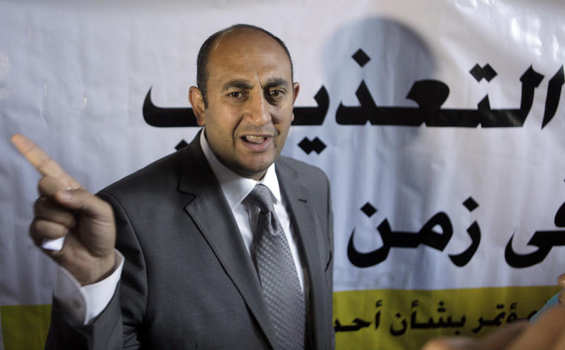 """Presidential candidate, Khaled Ali speaks in front of a banner with Arabic that reads, """"no to torture after the revolution,"""" in Cairo, Egypt, Sunday, May 20, 2012. Egypt's youngest presidential candidate has joined dozens of activists on hunger strike to protest the continued detention of more than 300 people who face possible military prosecution. (AP Photo/Amr Nabil)"""