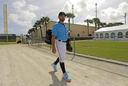 Miami Marlins catcher Francisco Cervelli walks to the field during the spring training baseball workouts for pitchers and catchers at Roger Dean Stadium on Wednesday, Feb. 12, 2020 in Jupiter, Fla. (David Santiago/Miami Herald via AP)