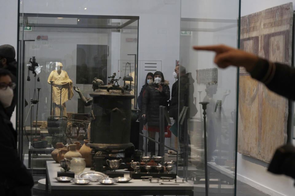 Journalists visit the museum Antiquarium, in Pompeii, southern Italy, Monday, Jan. 25, 2021. Decades after suffering bombing and earthquake damage, Pompeii's museum is back in business, showing off exquisite finds from excavations of the ancient Roman city. Officials of the archaeological park of the ruins of the city destroyed in 79 A.D. by the eruption of Mount Vesuvius inaugurated the museum on Monday. (AP Photo/Gregorio Borgia)