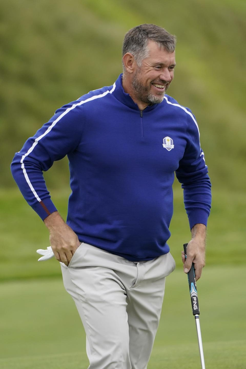 Team Europe's Lee Westwood smiles as he putts on the 11th hole during a practice day at the Ryder Cup at the Whistling Straits Golf Course Tuesday, Sept. 21, 2021, in Sheboygan, Wis. (AP Photo/Jeff Roberson)
