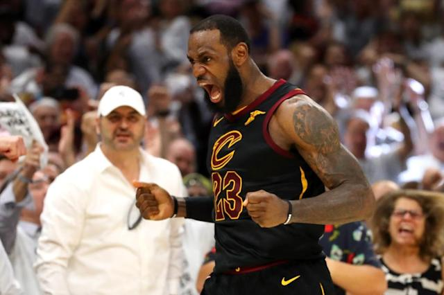 LeBron James of the Cleveland Cavaliers reacts after a basket in the fourth quarter against the Boston Celtics during Game Six of the 2018 NBA Eastern Conference Finals at Quicken Loans Arena on May 25, 2018 in Cleveland, Ohio (AFP Photo/Gregory Shamus)
