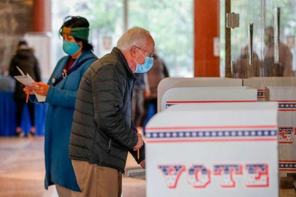 PHOTO: A man casts his ballot at the Frank P. Zeidler Municipal Building on the first day of in-person early voting for the Nov. 3, 2020, elections in Milwaukee, Wis., Oct. 20, 2020. (Kamil Krzaczynski/AFP via Getty Images)