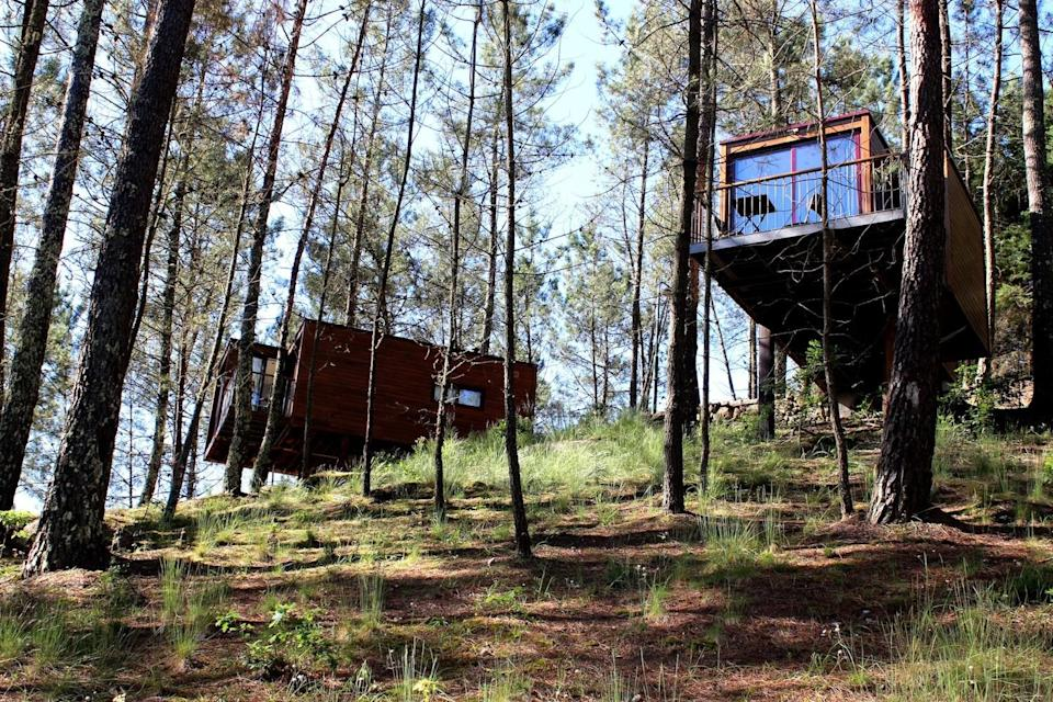 """<p><span>The pine forest pitches at </span><a href=""""https://coolcamping.com/campsites/europe/portugal/porto-northern-portugal/1197-lima-escape"""" rel=""""nofollow noopener"""" target=""""_blank"""" data-ylk=""""slk:Lima Escape"""" class=""""link rapid-noclick-resp""""><span>Lima Escape</span></a><span> in the Peneda-Gerês National Park offer shade and shelter with splinted views of the River Limia beyond. Natural and largely untouched, camping spots come with all the roots and bumps that nature intended. For a touch of luxury (and a proper bed), book one of the furnished, stilted cabins in the trees. A tent and two people from €20 (£17). [Photo: Cool Camping]</span> </p>"""