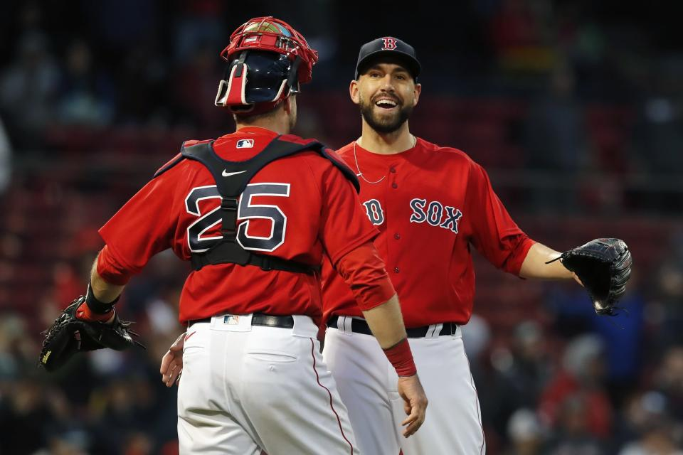 Boston Red Sox's Matt Barnes and Kevin Plawecki (25) celebrate after defeating the Miami Marlins in the ninth inning of a baseball game, Saturday, May 29, 2021, in Boston. (AP Photo/Michael Dwyer)