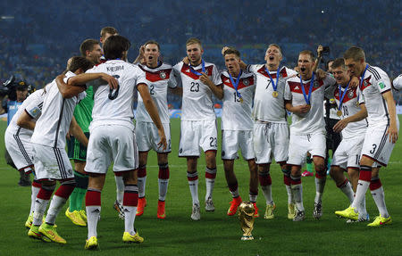 Germany's players celebrate with the World Cup trophy after the 2014 World Cup final against Argentina at the Maracana stadium in Rio de Janeiro