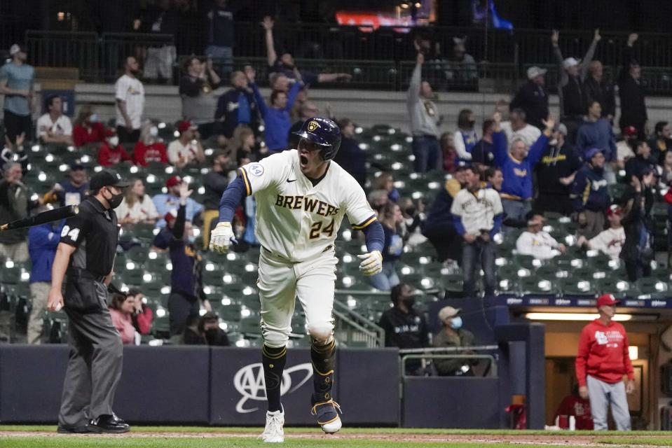 Milwaukee Brewers' Avisail Garcia hits a two-run home run during the eighth inning of a baseball game against the St. Louis Cardinals Wednesday, May 12, 2021, in Milwaukee. (AP Photo/Morry Gash)